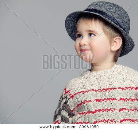 Baby boy wearing a hat.