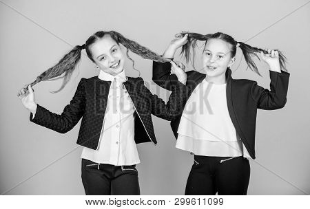 Beautify your hair today. Little girls with long blond hair. Small girls with hair into ponytails. Hair models with beauty looks poster