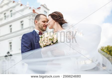 Loving Couple Of Newlyweds Walks In The Old City In Wedding Day