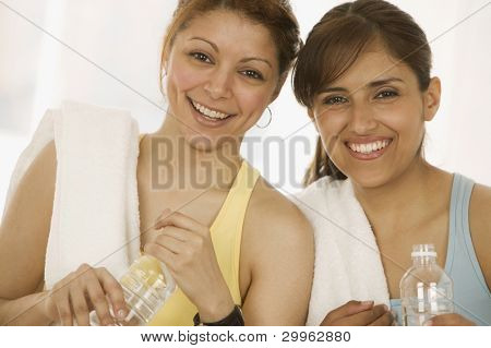 Portrait of women with water bottles