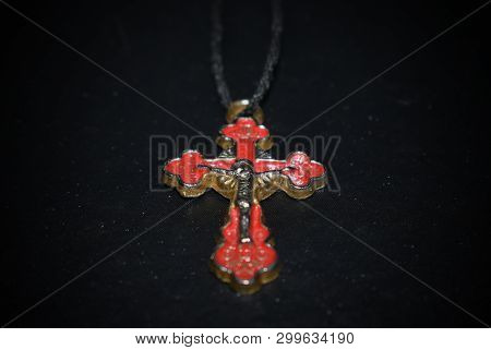 Stock Photo Of Both Parties Of A Silver Orthodox Cross On A Black Background
