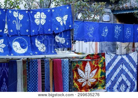 Xizhou, Yunnan, China - November, 2018. Colorful Fabrics Stretched Out In The Sun In The Village Of