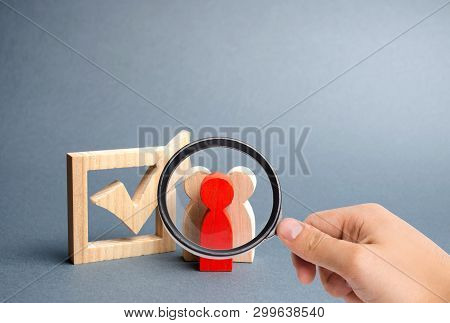 Magnifying Glass Is Looking At People Stand Near The Checkbox For Voting In Elections. Lobbying Inte