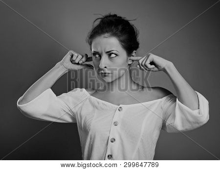 Stressed Unhappy Casual Woman Closed Ears The Fingers Because Not Want The Hear Any Sounds And Noise