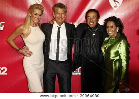 LOS ANGELES, CA - FEB 10: David Foster; Smokey Robinson at the 2012 MusiCares Person of the Year Tribute To Paul McCartney at the LA Convention Center on February 10, 2012 in Los Angeles, California
