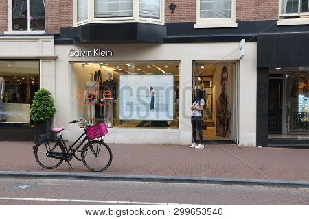 Amsterdam, Netherlands - July 10, 2017: Person Visits Calvin Klein Fashion Shop At P.c. Hooftstraat