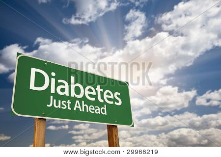 Diabetes Just Ahead Green Road Sign with Dramatic Clouds, Sun Rays and Sky.