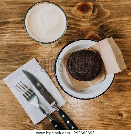 Cup Of Coffee And Chocolate Cake On Wooden Table. Vintage Fork And Knife. Squred Photo Vintage Dish