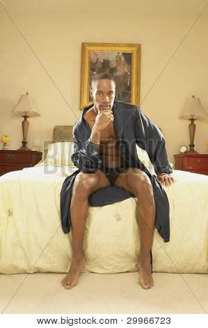 Man in robe in bedroom