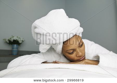 Woman in bathrobe with towel on head