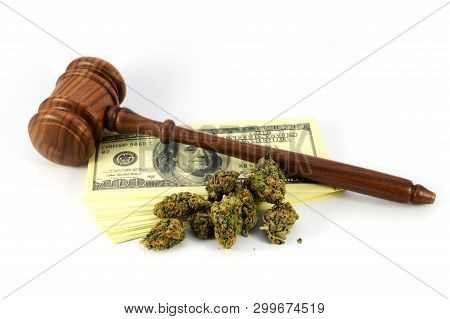 A Concept Of The Revenue Made From Legalized Weed With A Wooden Gavel And Marijuana With American Ba
