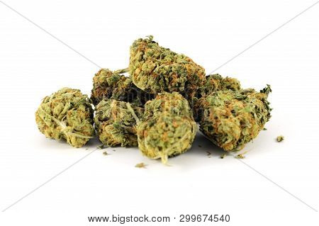 An Isolated Pile Of Fresh Weed Or Marijuana Over A White Background.