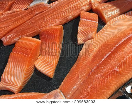Sliced Raw Salmon Or Fresh Salmon. Salmon Fillets For Sale At Market Displayed With A Patchwork Effe