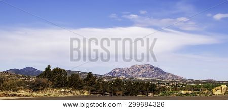 Distant Mountains In The Prescott National Forest As Seen From The Parking Lot At Watson Lake In Pre