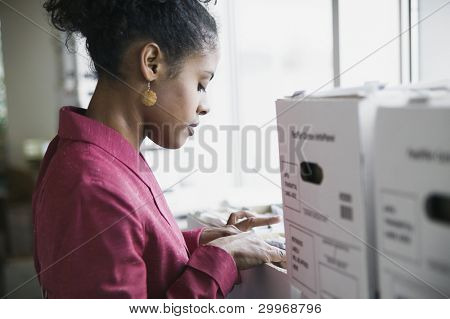 Businesswoman looking through files