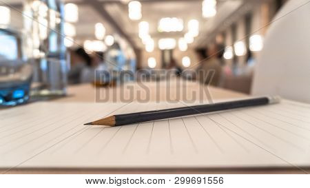 Business Agenda Briefing Shorthand Note In Seminar Workshop Or Convention Hall Meeting Room With Pen
