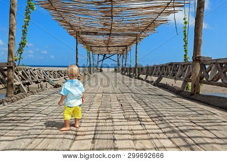 Happy Baby Boy Walk With Fun By Wood Bridge To Sunny Ocean Beach. Active Children Lifestyle, Summer
