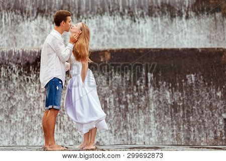 Happy Family On Honeymoon Holidays - Married Loving Couple Hugging, Kissing With Fun Under Falling W