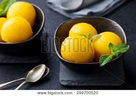 Mango Ice Cream, Tropical Fruit Sorbet In Black Bowl On Slate Background. Close Up.