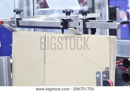 poster of The brown Carton / Box Erector Machine ; close up