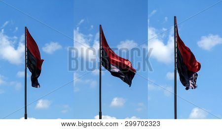 Set of three Right Sector flags isolated on blue sky background. Silk black and red flags on a flagpole flying in the wind in the air poster