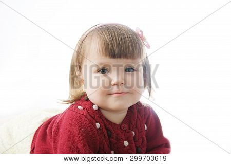 Little Girl Portrait Smiling Happy. Cute Caucasian Baby Isolated On White Background