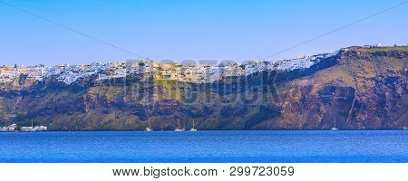 Sunrise Panoramic Banner Of Oia Village In Santorini Island With Colorful Houses And Blue Sea, Greec