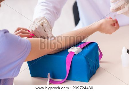 Female patient during blood test sampling procedure