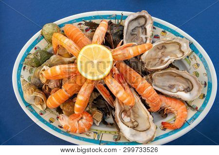 Plateau De Fruits De Mer, Traditional French Seafood Plate Of Raw And Cooked Shellfish Such As Oyste