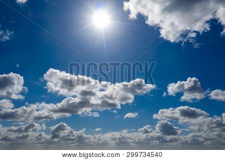 A Dreamlike Blue Sky With White Sheep Clouds