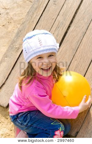 Child Holds A Ball