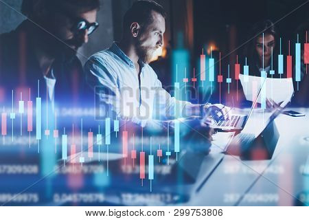 Business Team Working Together At Night Office.technical Price Graph And Indicator, Red And Green Ca