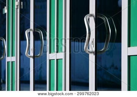 Chrome Door Handle And Glass Of Modern Aluminium Office Facade