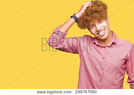 Young handsome business man with afro hair confuse and wonder about question. Uncertain with doubt, thinking with hand on head. Pensive concept.