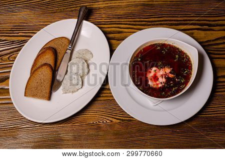 Hodgepodge And Baked Chicken With Mushrooms And Bread, And A Spoon And A Fork On A Table, Lunch Dish