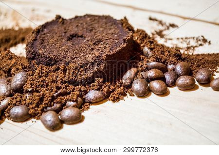 Three Stages For Preparation Of Coffee: Grain, Crushing And The Pressed Tablet. Wooden Surface. Espr