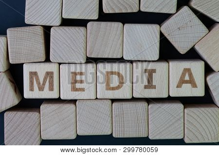 Media, Social Media Press And News Concept, Cube Wooden Block With Alphabet Combine The Word Media O