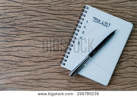 Task List, Project Management Concept, Pen On White Paper Notepad With Handwritten Headline As Task