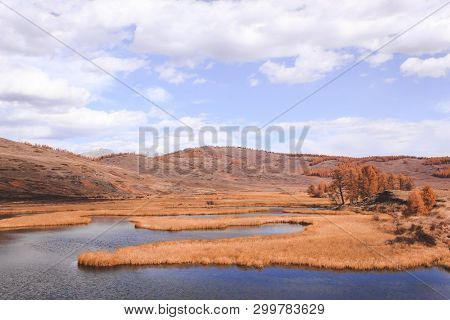 Autumn Panorama. View Of Mountains And Lake. Mountain Range On Horizon. Travel To Mountain Valley Wi