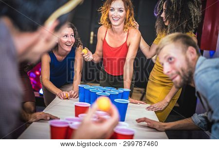 Young Friends Playing Beer Pong At Youth Hostel - Free Time Travel Concept With Backpackers Having U