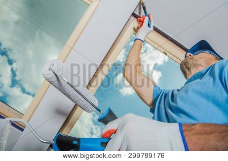 Caucasian Room Painter Finishing Apartment Window Edges. House Remodeling And Painting.