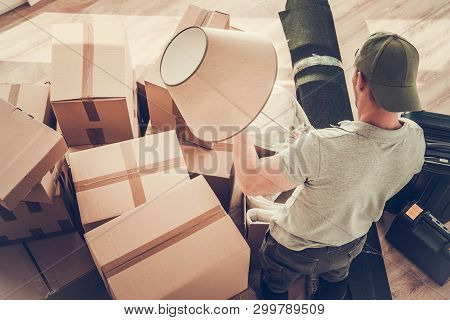 Caucasian Divorced Men In His 30s Moving Out From His Home. Staying Between Cardboard Boxes Preparin
