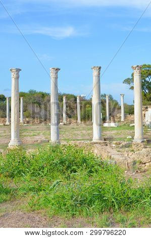 Beautiful Antique pillars with blue sky above. The columns were part of Salamis Gymnasium located near Famagusta in Northern Cyprus. Archeological site with historical significance poster