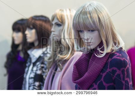 Realistic Female Mannequins Stand In A Row In The Store. Sales