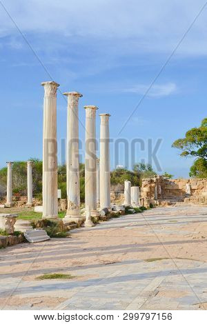 Amazing view of the Salamis ruins in Northern Cyprus taken with blue sky above. Salamis was famous Antique Greek city. The Corinthian columns were part of Salamis Gymnasium poster