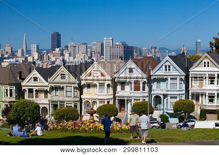 San Francisco, Ca,usa - July 20, 2011: Victorian Houses In San Francisco With Downtown In The Backgr