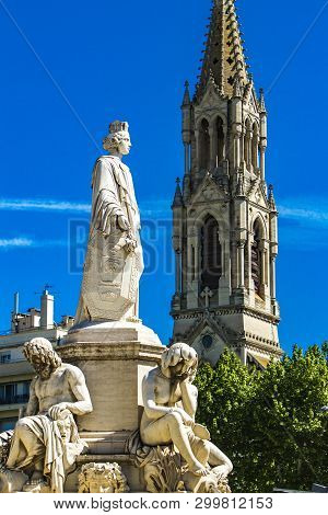 Detail Of Pradier Fountain At Esplanade Charles-de-gaulle With Eglise Sainte Perpetue In The Backgro