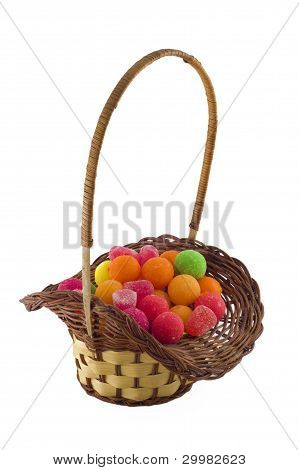 Small Basket With The Multi-colored Sweets.