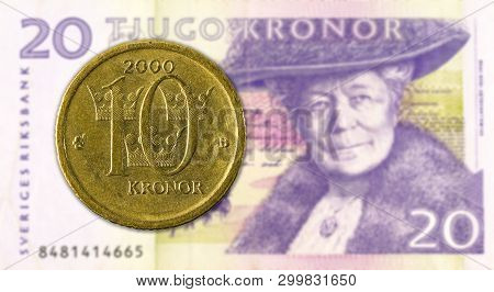 10 Swedish Krona Coin Against 20 Swedish Krona Bank Note