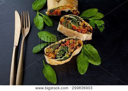 Vegetable Savory Strudel, With Tomatoes, Bell Pepper, Mushrooms On Black Background